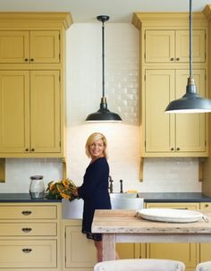 Love these extra tall shaker style yellow cabinets!