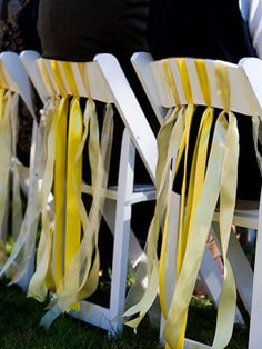 """10. Deck out the chairs    A few ribbon or fabric garlands will take simple ceremony chairs to the next level. For guests of honor (like immediate family), make simple """"reserved"""" signs to hang on their chairs."""