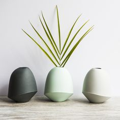 """We love the unique shape of these ceramic bud vases from Bean & Bailey. Available in three versatile shades that look great grouped together, or by themselves. size: 4.5x3.5"""""""