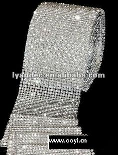 Crystal rhinestones....can also buy at fabric store.  Try covering tea light glass.