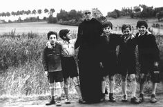 Father Bruno with Jewish children he hid from the Germans. Yad Vashem recognized Father Bruno as Righteous Among the Nations. Belgium, wartime.