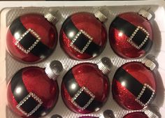Santa ornaments - made with Pledge floor polish and glitter inside, electrical tape for the belt, and crystal stickers from Hobby Lobby for the buckle.