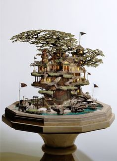 Japanese artist Takanori Aiba creates fantastically detailed tiny tree houses atop bonsai trees. Using copper line, epoxy putty, plastic, resin and stone clay, he fashions detailed buildings, bridges, balconies and towers.