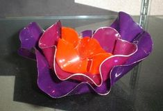 Students looked at slides of work by glass artist Dale Chihuly before beginning this project.