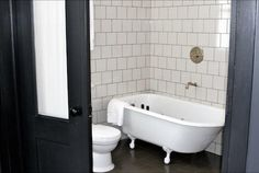 Bathrooms with white tiles and dark grout.  This one from the Ace Hotel in New York.