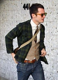 Wearing classic pieces, not letting them wear you.  Elijah Wood. Plaid jacket, tweed vest, and jeans.