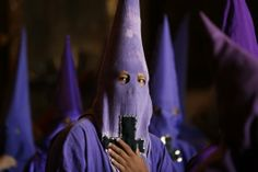 """Hooded penitents known as """"cucuruchos"""" participate in a Holy Week procession on Good Friday in Quito, Argentina. World Religions, Holy Week, Good Friday, Quito, Latin America, Celebration, Easter, Around The Worlds, Argentina"""