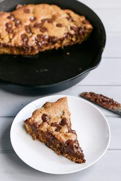 Nutella Stuffed Deep Dish Skillet Cookie | https://cafedelites.com