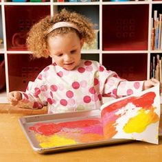 ITEM: Art  Not a MOD requirement, but baking sheets are a great idea to use as portable locations for drawing/scribbling/paining outdoors with toddlers.