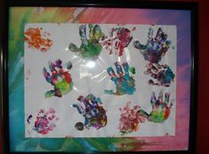 The kids' hand prints ... fun finger paint project turned art :)