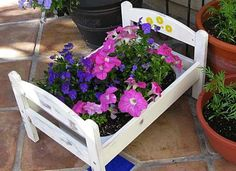 Here's an IKEA hack that doubles as a fun—a REAL flower bed! This sweet doll bed frame is the perfec... - ikeahackers.net