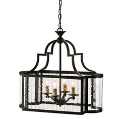 This rectangular lantern is made very special with sides of multi-panel glass. The ends are curved, giving it a particular grace. The wrought iron frame is finished with Old Iron.