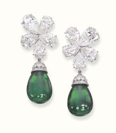 A PAIR OF SUPERB EMERALD AND DIAMOND EAR PENDANTS, BY GRAFF   Each set with a detachable drop-shaped emerald to the marquise and circular-cut diamond cap, suspended from a pear-shaped diamond five-stone cluster top, mounted in platinum, in a Graff black leather case  Signed Graff, no 3160