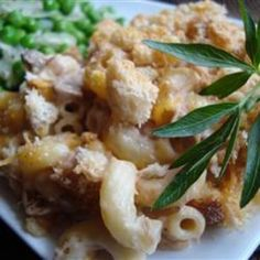 Cheese Lover's Tuna Casserole  	    Share                  Ingredients 1 cup elbow macaroni 1 (10.75 ounce) can condensed cream of mushroom soup 2 (6 ounce) cans tuna, drained 1 pound Cheddar cheese, cubed 1 1/2 cups seasoned croutons