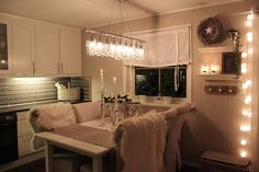 Looove these floating white shelves + circle lights hanging from the curtains