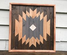 Handmade Geometric Wood Art. Each piece is stained, cut, and arranged to create an eye-catching pattern to enhance any space. Perfect for a housewarming, anniversary, Christmas, wedding, or birthday gift! • Piece measures approximately 19x19 inches. • Hanging hardware included. Each