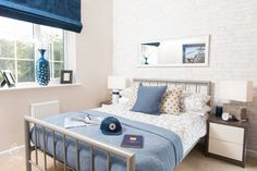 Double bedroom in our 4 bedroom Raglan property. Navy and whites interior design. Market Quarter in Holsworthy by Cavanna Homes- 2, 3 & 4 bedroom new homes