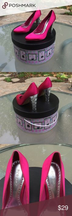 🎀 BCBGirls Pink w/Silver Diamond Heels, Wm. 9.5B! Gorgeous! BCBGirls Hot Pink Pumps in Women's Size 9.5B. Pink Satin Top, Leather-Bottom, Silver-Diamond Shape Design on heels. Worn once or twice. Heels are approx. 4 1/2 inches high. Perfect for a night on the town, holiday events, etc. Expect to get a lot of attention wearing these beauties! Thank you for shopping here. Please check out other items for sale in my closet. I 💗my Posher Pals! Debbie 😘 BCBGirls Shoes Heels