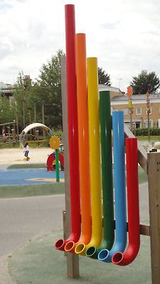 Playground pipes use as a wall for the garden or next to the shed to add color