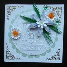 Hand made card using Husking, quilling, punched daisies, happy birthday folder and embossed gold corners