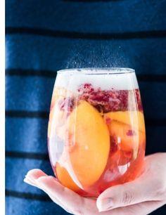 Yummy sparkling peach sangria. Perfect summer drink.