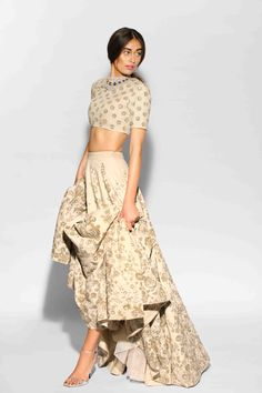 //elegant beaded taupe and gold lehenga
