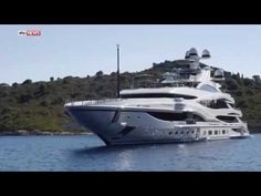 Billionaire Philip Green, holidaying on a super yacht, lunges at a TV crew…