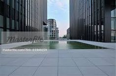 building image with water stock photo - Google Search Building Images, Buildings, Sidewalk, Stock Photos, Google Search, Water, Outdoor Decor, Gripe Water, Side Walkway
