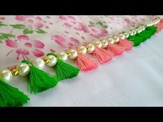 Simple, Quick, Very Easy Pearls Saree Kuchu. If you like this kuchu design, please Hit 👍Like, leave your valuable Comment and S. Saree Tassels Designs, Saree Kuchu Designs, Saree Blouse Neck Designs, Hand Work Blouse Design, Fancy Blouse Designs, Flower Embroidery Designs, Simple Embroidery, Saree Embroidery Design, Arabic Bridal Mehndi Designs