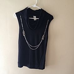 Wet seal fancy black top with jewelry attached This shirt is comfortable but also very glamorous for a night on the town or even to a party.  Pre loved. True to size. No trades ✅ Price Negotiable  ✅ Bundles ▪️smoke free/pet free home  Same/Next day shipping   Instagram: @laurenweichmann Pinterest: weichln Wet Seal Tops