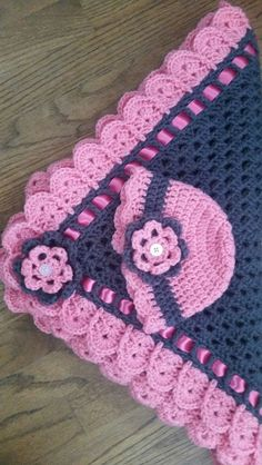 So this one started out as my sister finding this picture of a lovely blanket and wanted me to duplicate it for a gift. It isn't my original idea and I couldn't find the pattern listed in my usual hunting…Read more Granny Square and Ribbon Baby Blanket Set ›: