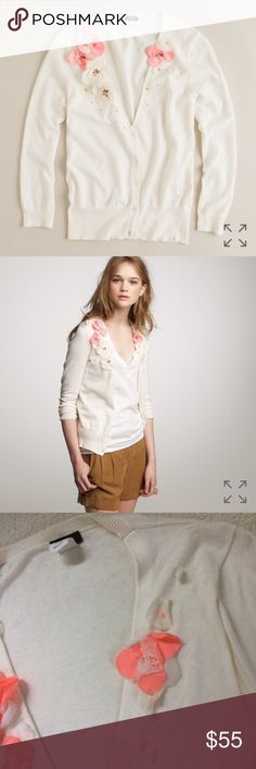 """J.Crew Fiore Flower Cotton Cardigan J.Crew """"Fiore"""" cardigan. 100% cotton with silk flowers appliqué. Off white cream color and flowers are coral and pink. V-neck button down. No rips or stains but please note that the flowers are wrinkled in some places. (Can try ironing them or pressing down with a weighted object!) J. Crew Sweaters Cardigans"""