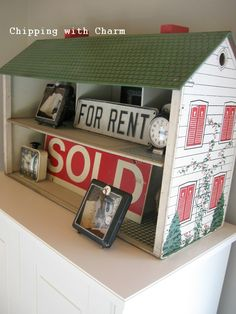 Give an old dollhouse new life as a funky display shelf.