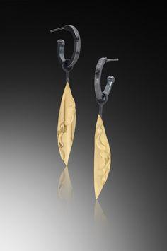Hoop Earring with Single Golden Leaf by Lori Gottlieb. Oxidized silver hoop earring with detachable drop of a single long 22k/sterling long leaf. Clutch back/post.