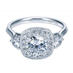 Love this stunning three stone solitaire engagement ring with a vintage inspired halo and gorgeous detailing underneath the crown!