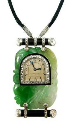 Diamond, onyx and jade pendant watch, signed Cartier, the arch shaped dial with baton and Arabic numerals, blued steel hands, diamond set bezel, inset to a two-tone oblong Chinese carved jade panel, an onyx branch-like baton above and below with rose diamond terminals and rose diamond straps, millegrain set, hung on a black cord with diamond set platinum ends, the case with backwind movement and numbered 78387 A