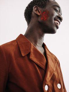 Paint smeared face at Grace Wales Bonner at Fashion East SS16 LCM. Photography Chloe Le Drezen.