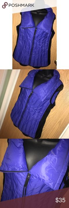 "Blue Calvin Klein performance down vest Super cute blue and black Calvin Klein performance down filled vest. Zipper closure. Great used condition. Super soft feel. Panels on the sides are stretchy. 22"" from armpit to armpit, 25"" total length. Calvin Klein Jackets & Coats Vests"