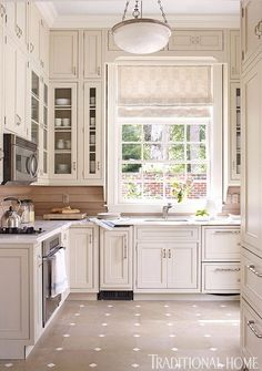 pool House kitchen designed by Marshall Watson, image via Traditional Home
