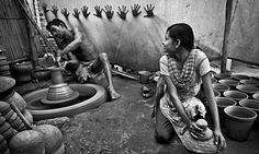 A teen girl is helping her father in a potter's village in Mankundu, West Bengal, India. Five years ago, they started the pottery in their home with a small loan from the Co-operative Bank. After making clay pots, they sell them in the local market of Chandanagar. It's a simple story of a potter's life. Photograph: Pranab Basak