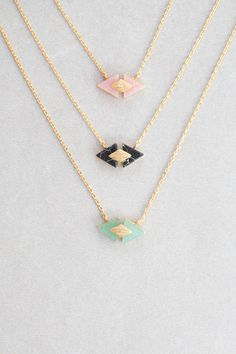 Dainty stone and gold charm necklace.
