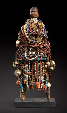 Africa | Dowayo/Namji doll from Cameroon | Wood body, wrapped in cloth and leather then covered in beads, cowrie shells, coins, bells and other metal objects | 21,150€ ~ Sold