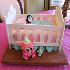 Happy tokidoki Fan Art Friday! Check out Cheryl's Toki Pery inspired baby shower cake! (Remember, she made the smash bowl to reveal her baby's gender). Cake is red velvet with a cream cheese frosting and covered with buttercream and fondant. Crib and decorations made with gumpaste and modeling chocolate! WOW!  If you would like to share your tokidoki creations, shoot us an e-mail — photos@tokidoki.it