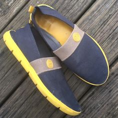 Tory Burch yellow and navy canvas shoes 8 I can't find the size on them, but I believe they are about an 8. I measured the bottom and its 10.5 in.  They are extremely comfy and have been well-loved already a lot, but still in good condition to keep wearing. Tory Burch Shoes Espadrilles