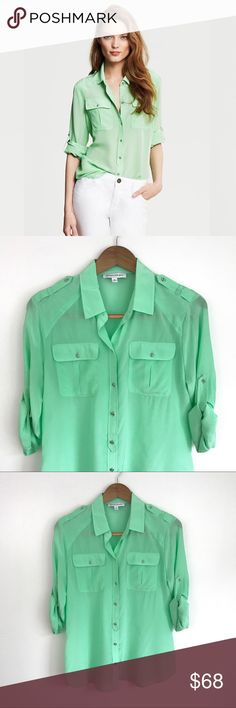 """Green Heritage Tipped Banana Republic Silk Blouse From Banana Republic's limited edition Heritage Collection, inspired by exploration and discovery. Features: rounded collar, buttoned epaulets, tipped chest pockets, button tab roll up sleeves, rounded hem. Hits at the low hip. 100% silk. Size M. Approx. 20"""" bust, 26"""" long from shoulder to hem. Never worn and in perfect condition! Banana Republic Tops Blouses"""