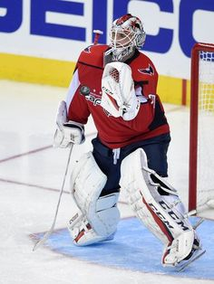 Washington Capitals goalie Braden Holtby (70) prepares to stop the puck during the third period of an NHL hockey game against the Pittsburgh Penguins, Wednesday, Oct. 11, 2017, in Washington. The Penguins won 3-2. (AP Photo/Nick Wass)