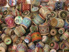 Wooden Spools of Thread With Embroidered Covers