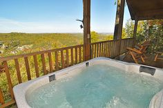Hot tub overlooking the fall colors on the deck of the All About Romance cabin in Pigeon Forge.