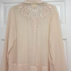HP NWOT UO Light Peach Embroidered Button-up Brand new sheer button up top from Urban Outfitters in a light cream/peach color. Has a beautiful embroidered detail on the back, and opens at the shirt tail. New without tag, but still has extra buttons attached. Size Large ❗️Price firm unless bundled❗️ Pins & Needles Tops Button Down Shirts