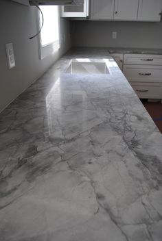 Kitchen Countertops super white quartzite/marble sub - Hello Everyone! I know, a post two days in a row. I think we made the right choice for the counters in the kitchen. We chose a quartzite, it is called Super White. It is somewhere betw… Kitchen Countertop Materials, Granite Kitchen, Kitchen Backsplash, Kitchen Cabinets, Shaker Cabinets, White Cabinets, Super White Granite, Super White Quartzite, Kitchen Redo